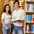 Portrait of students holding books — Foto de Stock