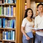 Students holding books — Stock Photo