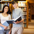 Portrait of young students with a book — Stock Photo