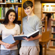 Beautiful students with a book — Stock Photo