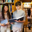 Smart students reading a book — Stock Photo