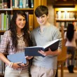 Smart students with a book — Stockfoto