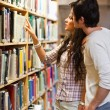 Portrait of students choosing a book — Stock Photo