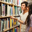 Stock Photo: Students choosing book