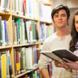 Young students holding a book — Stock Photo