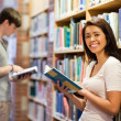 Foto Stock: Good looking student holding book