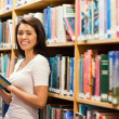 Beautiful student holding a book — Stock Photo