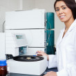 Stock Photo: Portrait of a scientist using a centrifuge