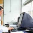 Female scientist using a monitor — Stock Photo