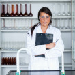 Portrait of a female scientist holding a clipboard — Stock Photo #11191159
