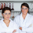 Serious female scientists posing — Stock Photo