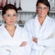 Portrait of female science students posing — Stock Photo