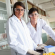 Science students wearing protective glasses — Stockfoto
