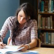 Young student writing — Stock Photo