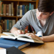 Portrait of handsome student writing essay — Stockfoto #11191418
