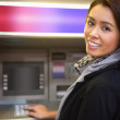 Woman withdrawing cash — Stock Photo