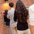Queuing to withdraw cash — Stock Photo