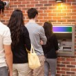 Stock Photo: Portrait of queuing to withdraw cash