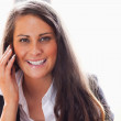 Smiling woman making a phone call — Stock Photo