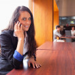 Smiling young woman making a phone call — Stock Photo