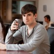 Young man having a coffee — Stock Photo #11191555