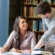 Young students helping each other — Stock Photo