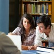 Portrait of smiling students working together — Stock Photo