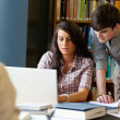 Students working together with a laptop — Stock Photo