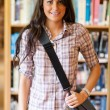 Portrait of a student holding her bag — Stock Photo