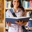 Portrait of a cute young student holding a book — Stock Photo #11191694