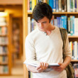 Royalty-Free Stock Photo: Serious student reading a book