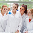 Royalty-Free Stock Photo: Portrait of science students looking at a flask