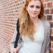 Portrait of a lovely student standing up - Foto Stock