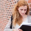 Lovely student reading her notes — Stock Photo