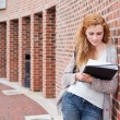 Young student reading her notes — Stock Photo