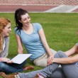 Happy students sitting together — Stock Photo