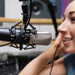 Close up of young radio host speaking — Stock Photo #11192588