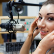 Close up of a young radio host posing — Stock Photo