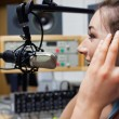 Stock Photo: Smiling radio host speaking