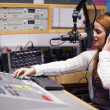 Stock Photo: Radio host mixing
