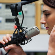 Close up of a cute singer recording a track — Stockfoto #11192648