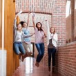Students jumping with their results — Stock Photo #11192674