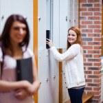 Student picking her binder in her locker — Stock Photo #11192702