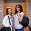 Young students holding their bags — Stock Photo #11192754