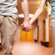Young couple holding hands - Stock Photo