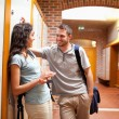 Foto Stock: Couple flirting in corridor