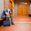 Sad student sitting on bench — Stockfoto #11193045