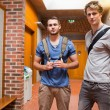 Handsome students posing — Stockfoto
