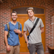 Smiling handsome students posing — Stock Photo
