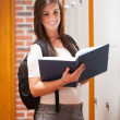 Stock Photo: Portrait of a student holding a book